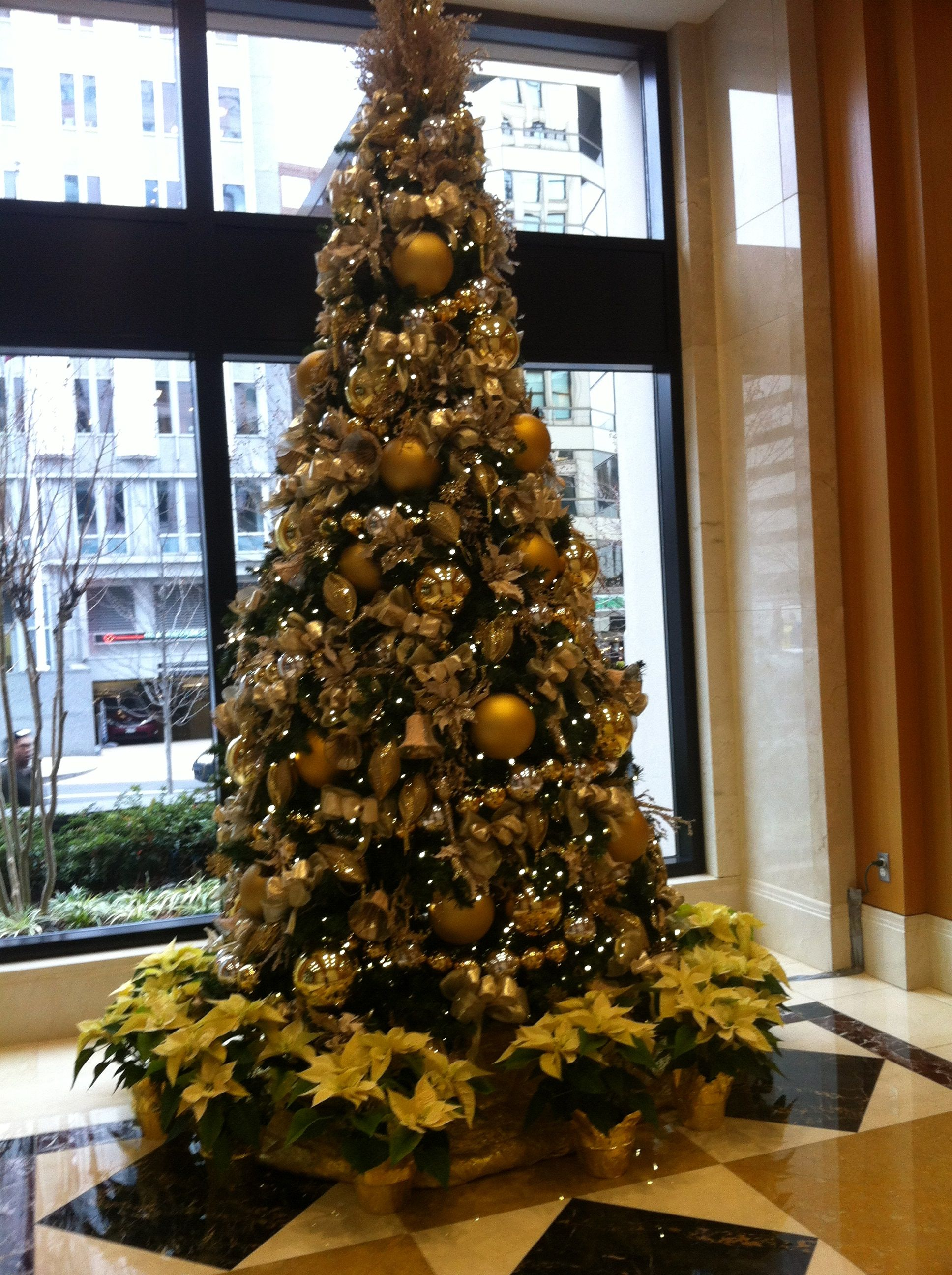 gold christmas tree in office building lobby gold christmas tree christmas mantels all things