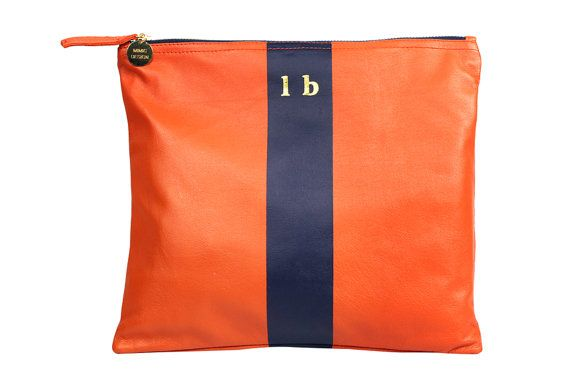 A chic carryall leather clutch for both day and night. Exclusive Orange with Navy stripe Leather Clutch  Monogramming in gold lower case. Select up