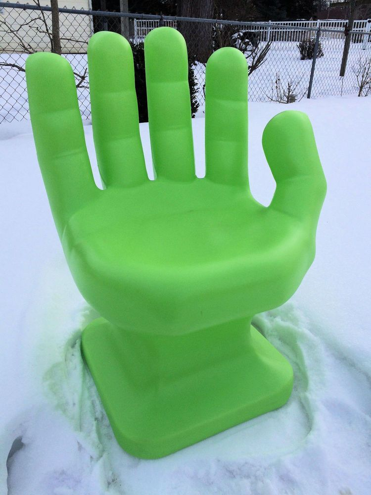 Giant neonlime green hand shaped chair neongreen
