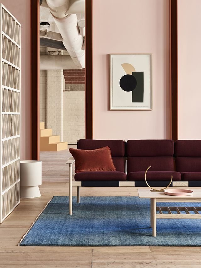 Love the open decorative concrete wall divider on this urban loft apartment