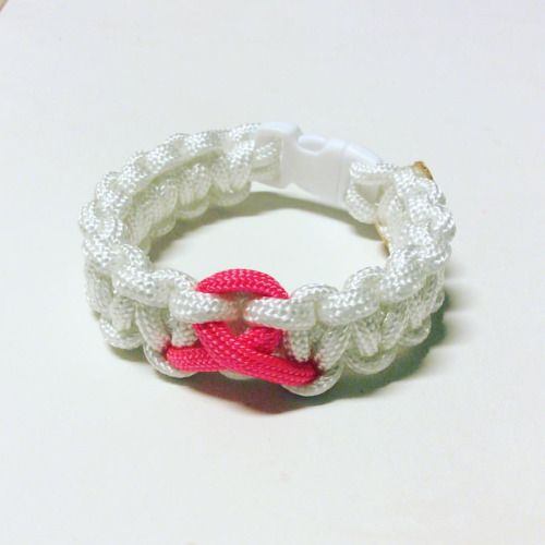 Pink Ribbon Cancer Awareness Paracord Bracelet. First one, just practice :) imagine any color you want with a pink ribbon.... #pink #cancer #paracord #paracordlife #paracordbracelet #cancersucks #cancerawareness #ribbon #breastcancerawareness