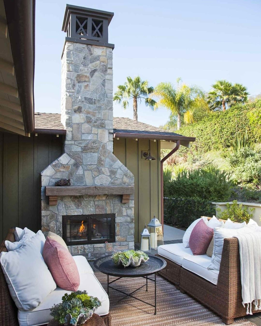 An outdoor fireplace is the ideal spot to gather around on