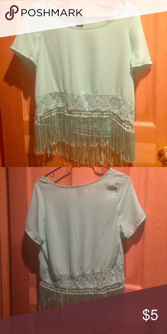 Blue shirt Blue shirt with fringe bottom and lace detail. Polyester fabric. Rue 21 Tops Tees - Short Sleeve