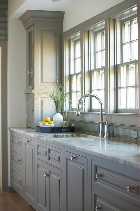 Stunning Kitchen Features Gray Cabinets Painted Benjamin Galveston Gray Paired With Fantasy Brown Granite Countertops And