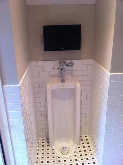 Ultimate Man Cave Bathroom    Full Length Urinal With Flat Screen T.V.  Above: