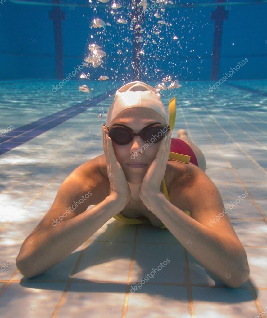 Woman at swimming pool bottom Royalty Free Stock Photos