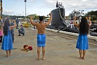 150310-N-CB621-117 JOINT BASE PEARL HARBOR-HICKAM, Hawaii (March 10, 2015) Hula dancers greet the crew of the Virginia-class attack submarine USS Hawaii (SSN 776) with traditional chants as they return to Joint Base Pearl Harbor-Hickam following a deployment. (U.S. Navy photo by Mass Communication Specialist 1st Class Jason Swink/Released)