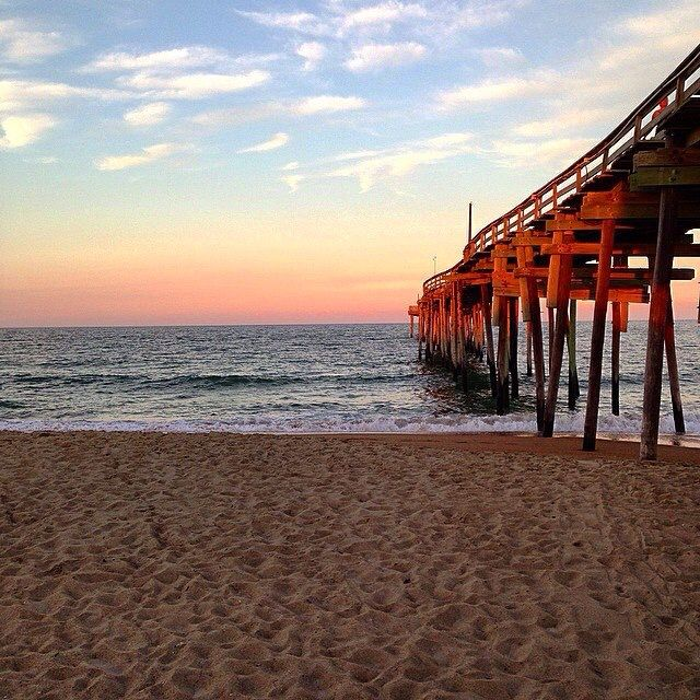 A beautiful sun rise on the pier at the outer banks.