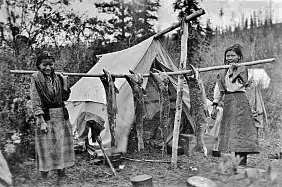 Athabascan Girls Displaying Salmon Near The Pelly River