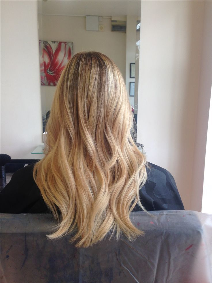 Photo of Gorgeous long hair with blonde balayage styled with loose curls – Galena U.
