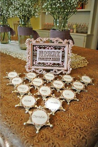 Baby's breath in mason jars and names on sherif badges