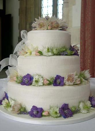 Fresh Flower Wedding Cake Organza Ribbon And Fresh Flowers Decorate This Classic Country