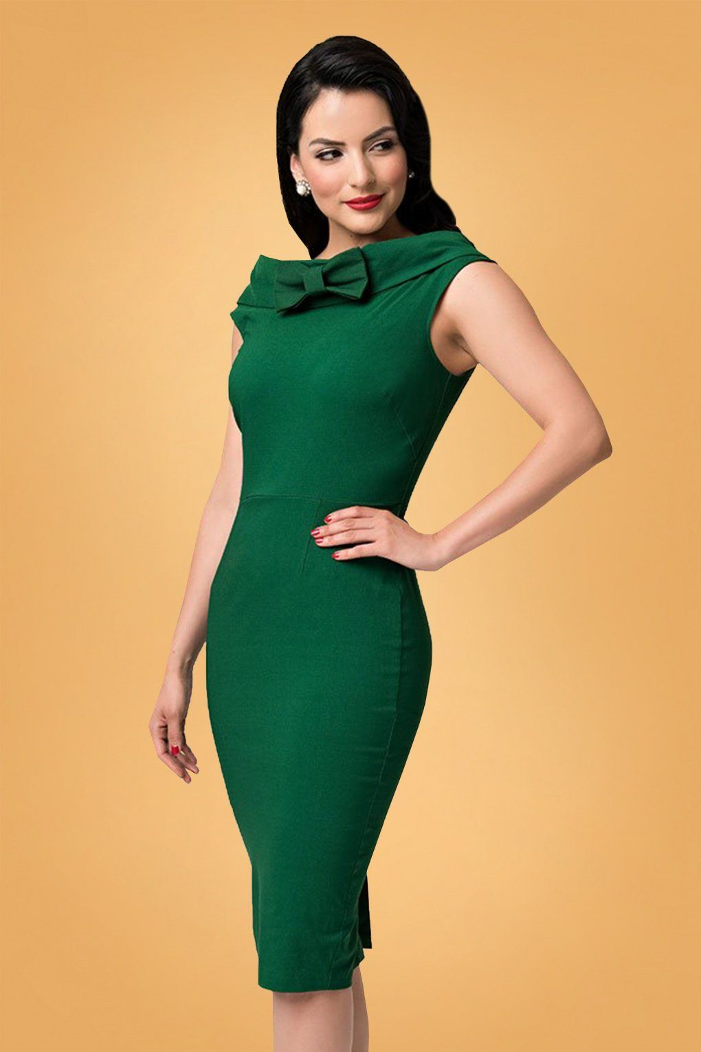 687061d46c7 A vintage dream come true... the Barbie x Unique Vintage collection! This  60s Barbie Sheath Dress in Emerald Green is a wardrobe essential!