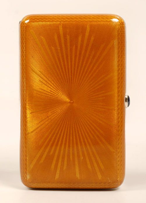 BOK Guilloche Enamel Cigarette Case ~ A Russian Silver, Parcel Gilt and Guilloche Enamel Cigarette Case, Bok, St. Petersburg, late 29th century. The Rectangular Case is Enameled in Translucent Orange Gold over an Engine-turned Starburst Pattern, Sapphire Thumb Push Opener Photo #1