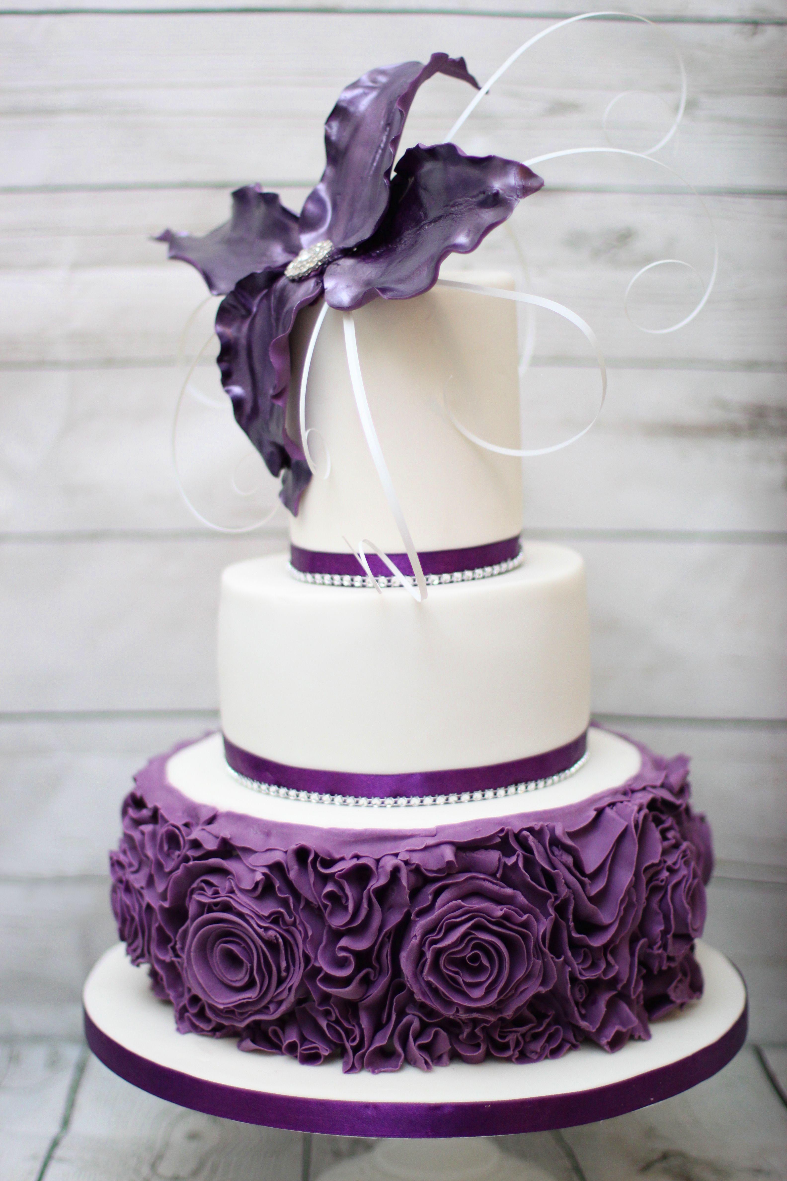 3 Tier cadburys purple birthday cake Ruffle roses and wired flower