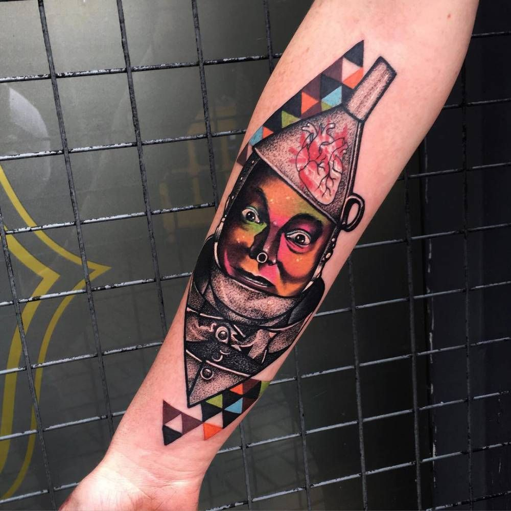 Psychedelic style Tin Man tattoo on the right inner