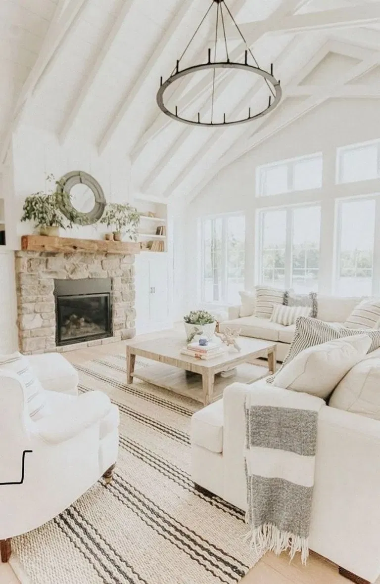 White Couch In A Boho Styled Living Room With A Round Wood Coffee Table Design Shop Interiors Trendy Living Rooms Living Room White Grey Interior Doors