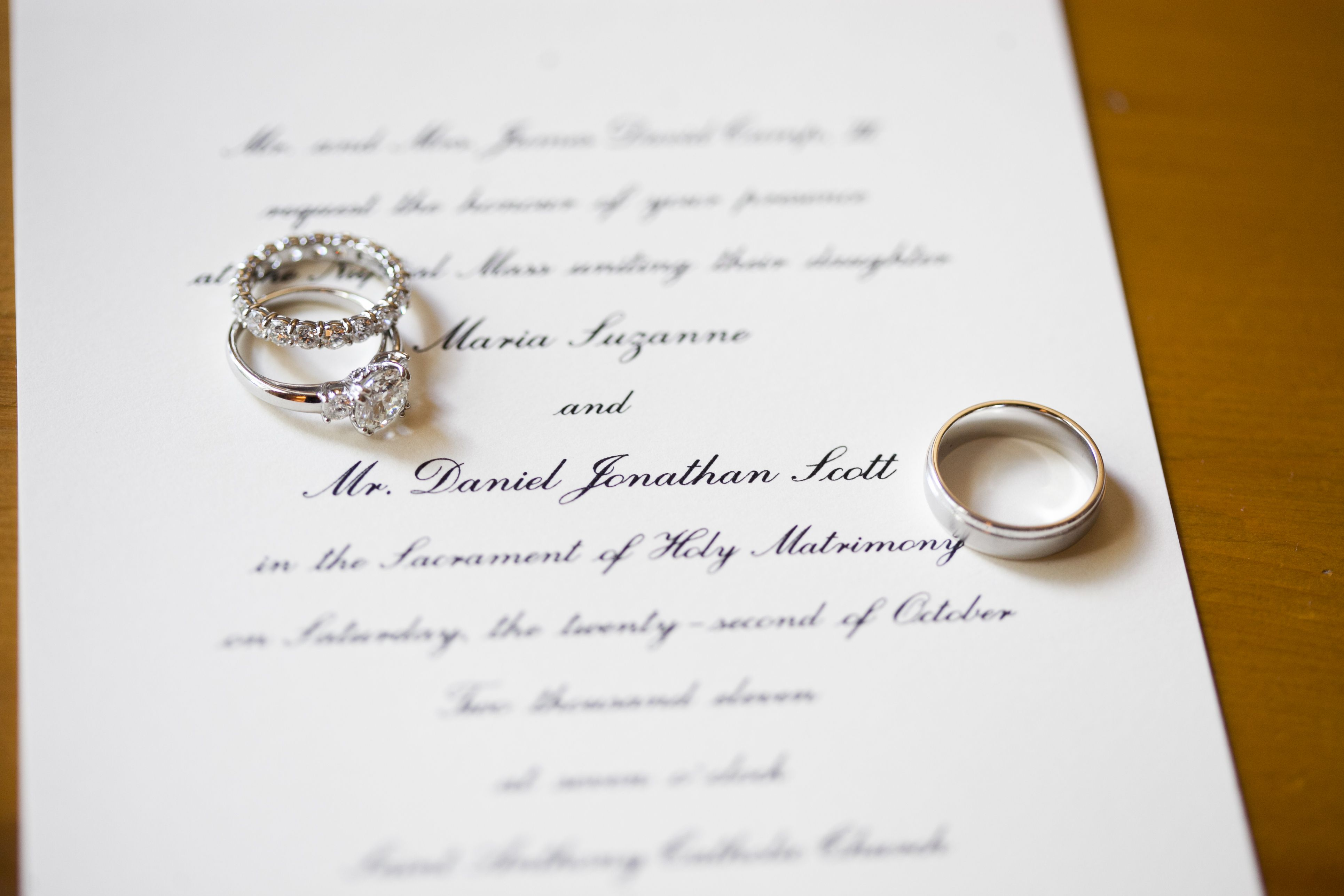 Engagement Ring And Wedding Bands Staged On The Invitation Wedding