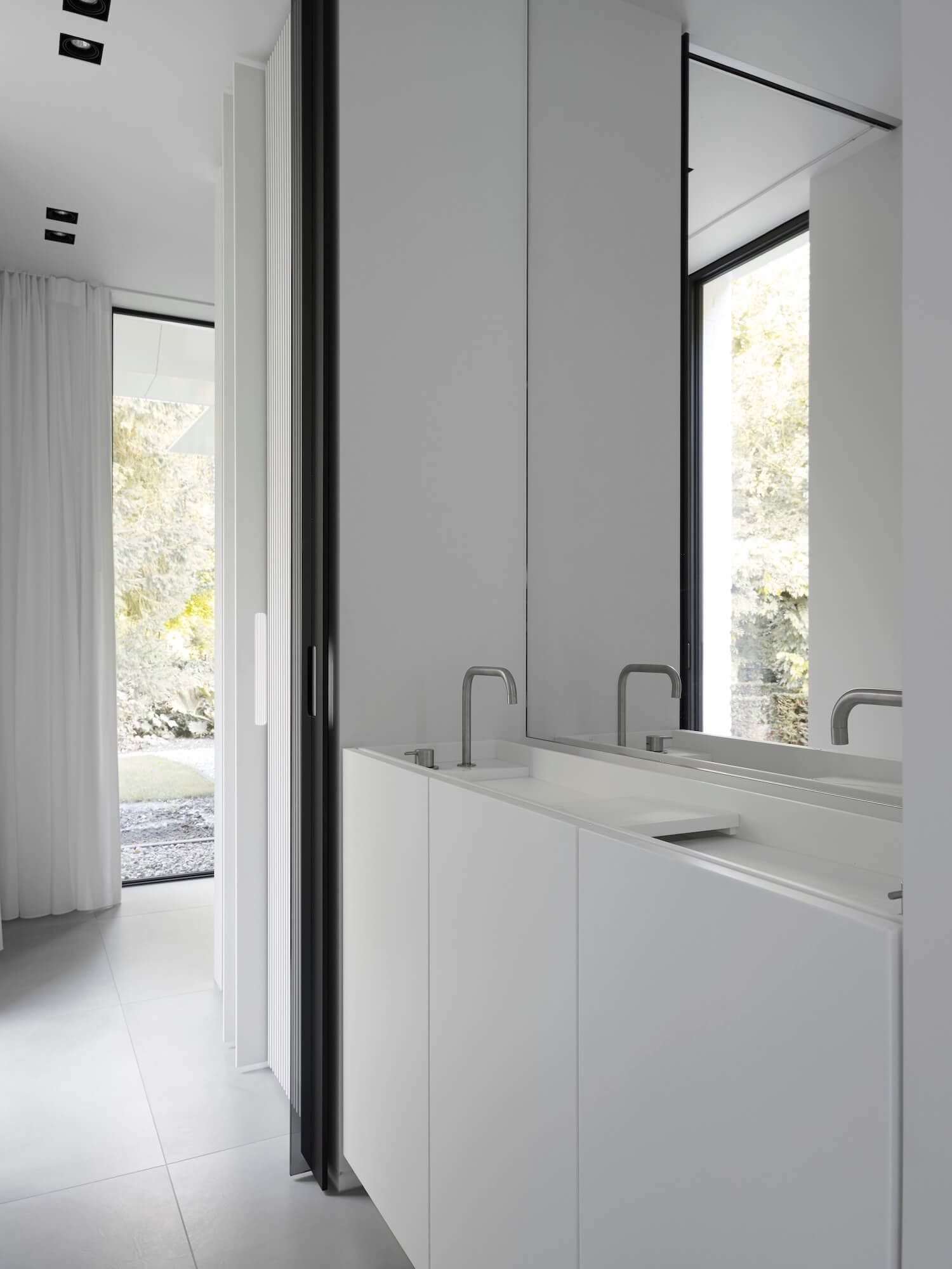 The Bright White House By Studio Niels Global Interiors Est Living White Bathroom Tiles Chic Home Decor House