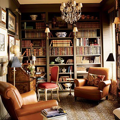 Southern Accents - library - red chair, chandelier, sconces and rug