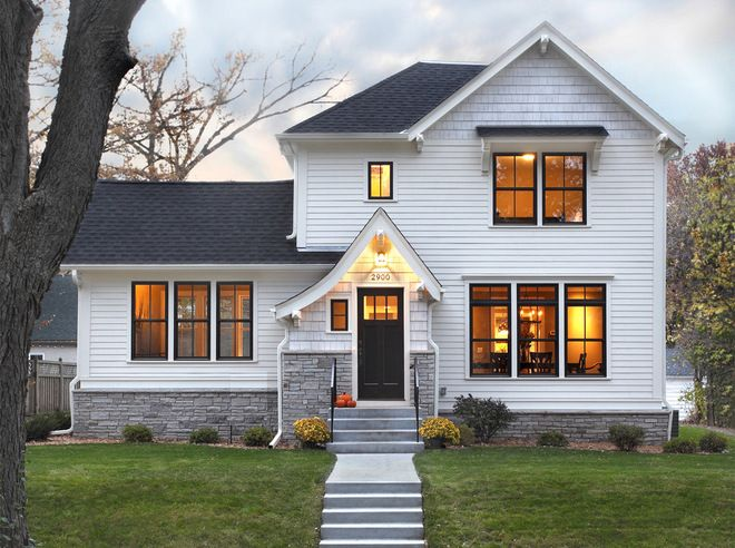 I love the dark roof white walls stone accents and black windows