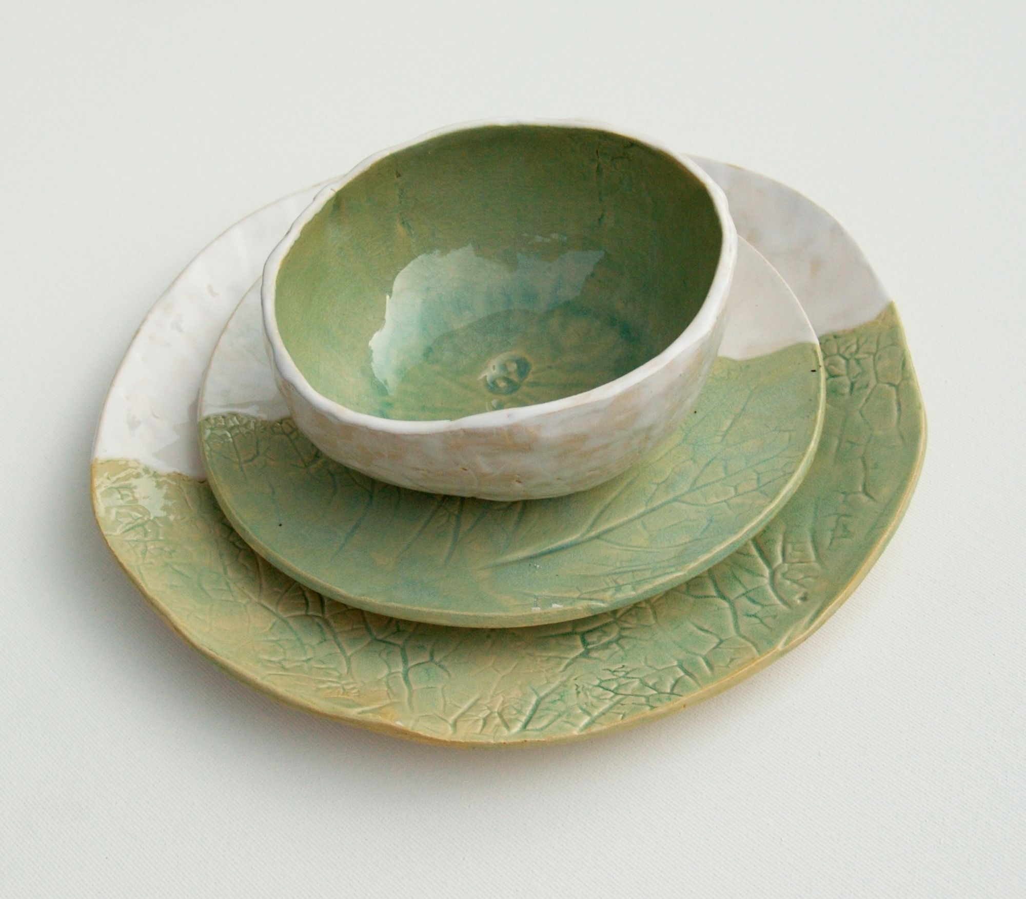 Amazing ceramics from By Blue Birds, Etsy seller from Poland. She's making functional pottery for your home. Tableware & teaware in amazing colors. These plates have pressed cabbage leaves, bowl was formed on pumpkin. #functionalceramics #handmadedinnerware #pottery #ceramicbowl #polishpottery Find @ByBlueBirds on Instagram.