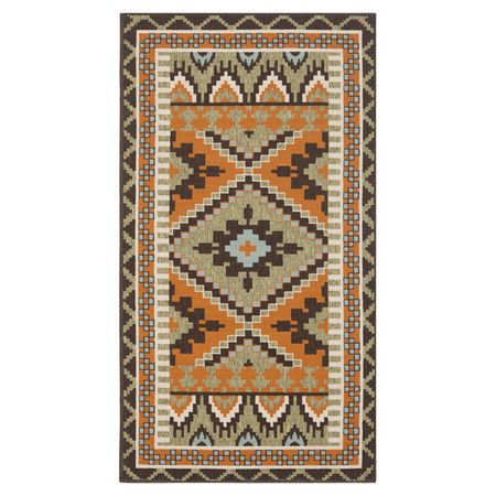 Rug with a Southwestern-style motif. Made in India.  Product: RugConstruction Material: Polypropylene