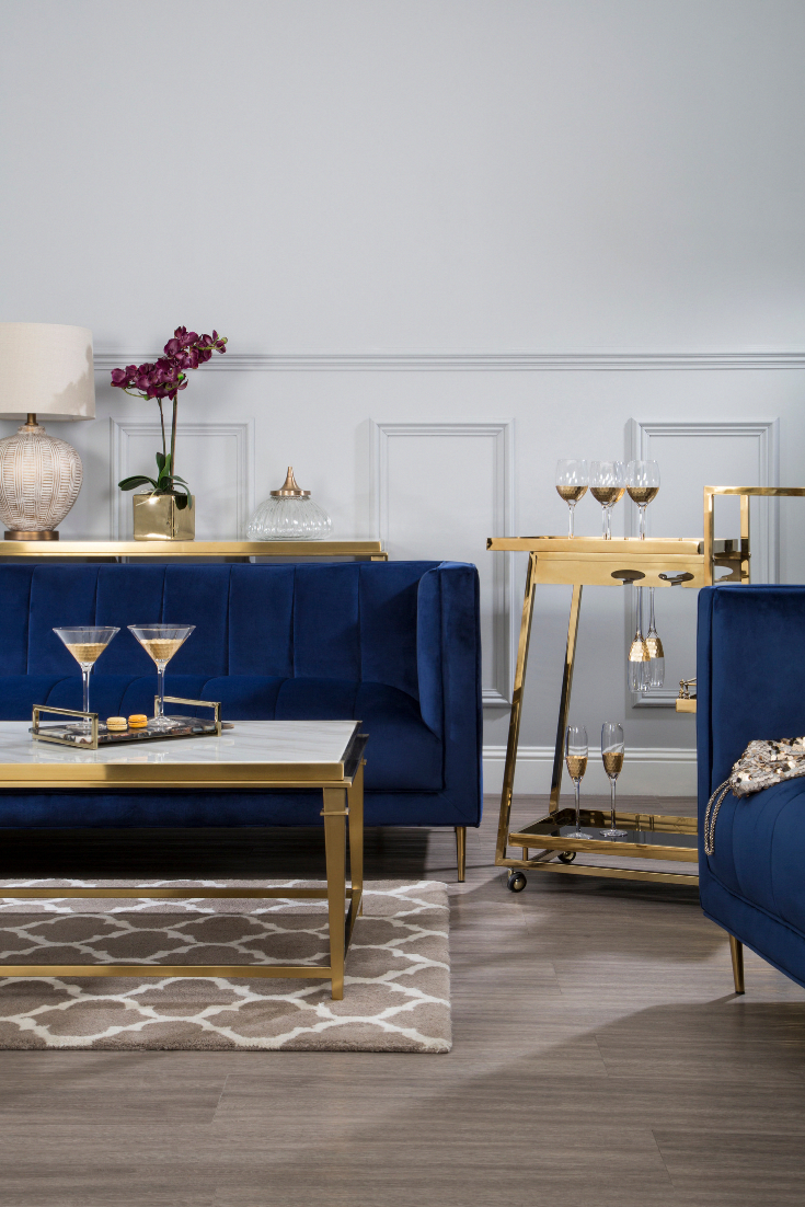 Blue Velvet Sofa With Gold Accents Beautiful Gold Bar Carts And Metallic Accessories In Velvet Couch Living Room Blue Living Room Decor Blue Sofas Living Room