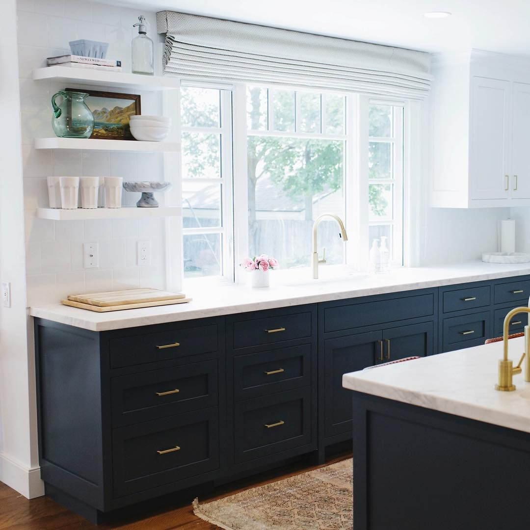 Love the open shelving next to the sink and the Roman shade ...