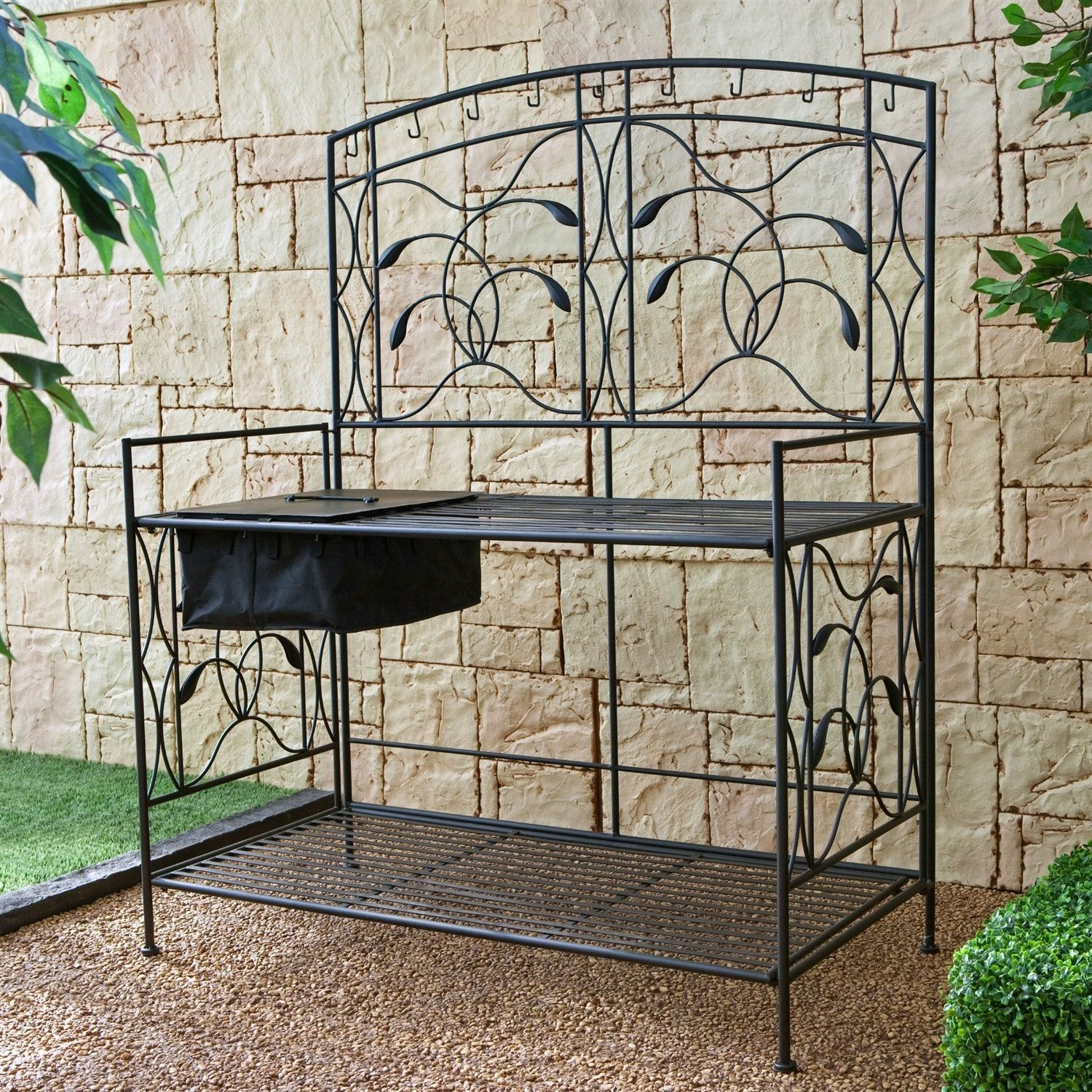 Black Metal Potting Bench With Wrought Iron Vine Details And