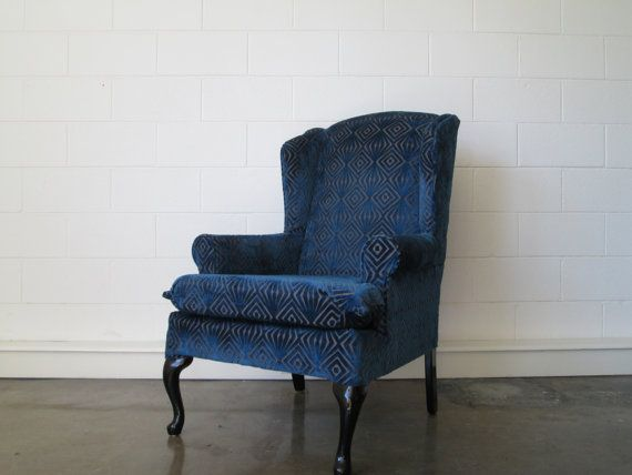 Wingback chair in deep blue velvet pattern and textured fabric  which gives the classic shape a modern twist on Etsy, $400.00