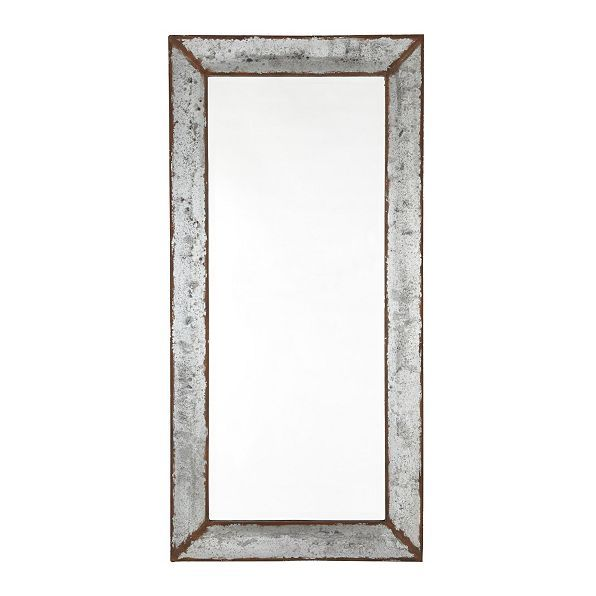 The rustic weathered finish of our zinc framed mirror reminds us of the metal flower pots