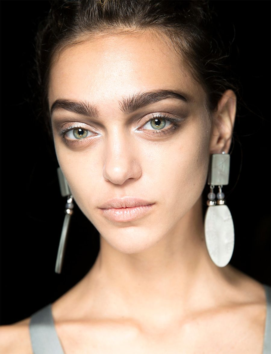 Makeup style for SS 2015: Shimmering silver inner eye tear-duct + dusty earthy smokey eye makeup. Giorgio Armani Spring Summer 2015. #makeup