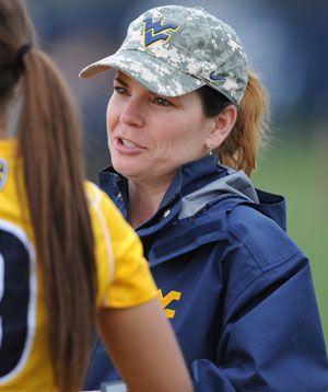 WVU women's soccer coach Nikki Izzo-Brown sports a camo Flying WV hat.