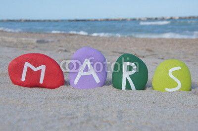 Mars on colourful stones over the beach