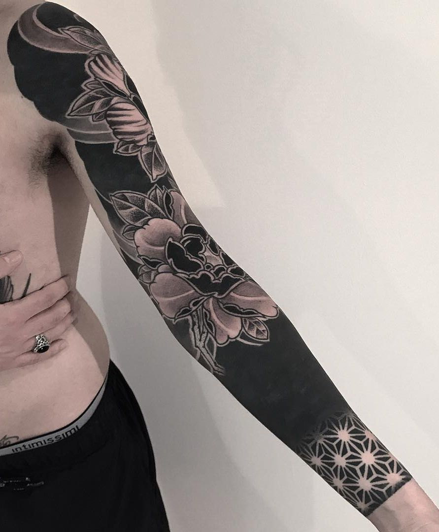These Striking Solid Black Tattoos Will Make You Want To Go All In Black Sleeve Tattoo Black Tattoos Solid Black Tattoo