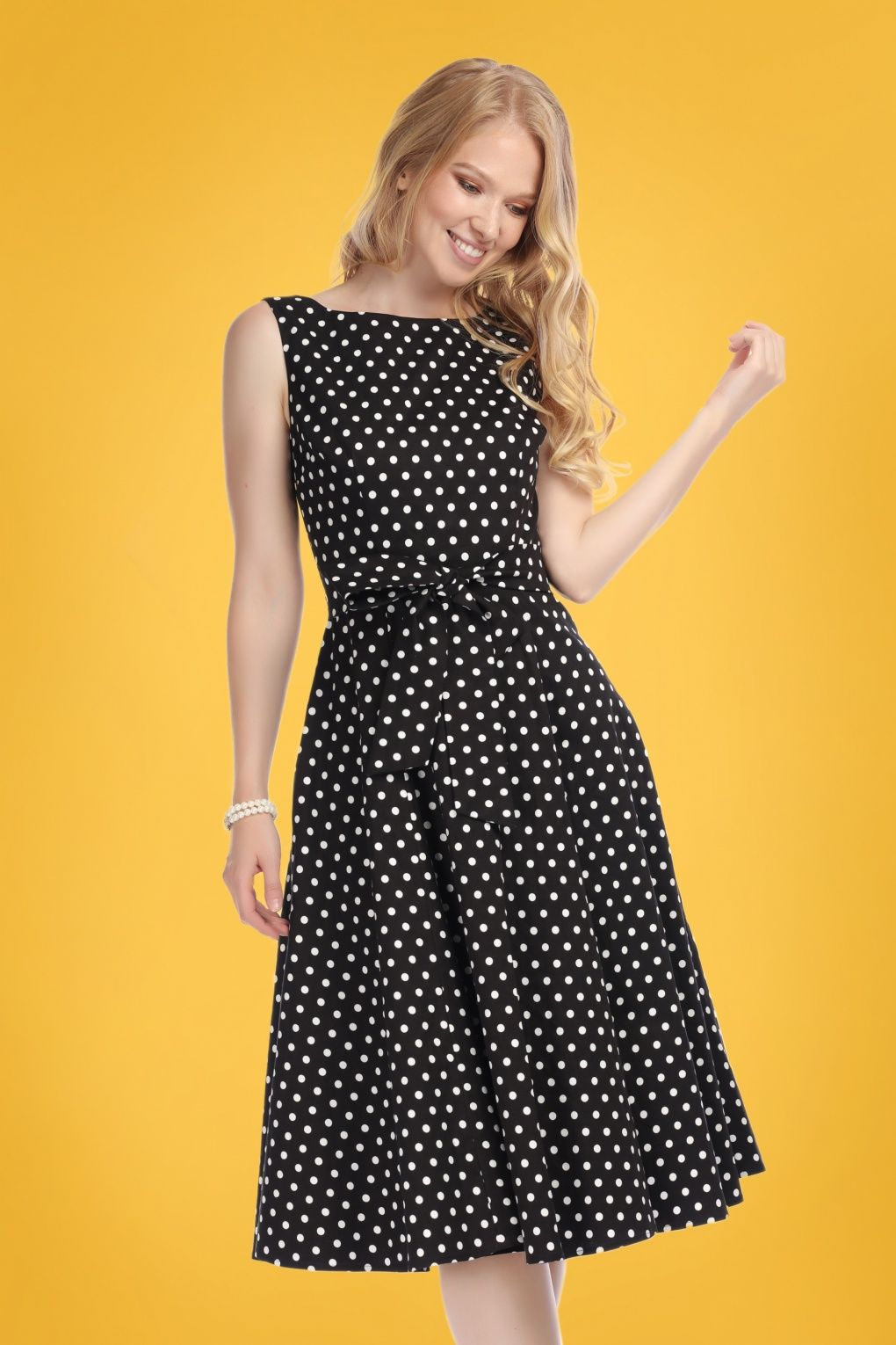 c373e7d25ddec Swing into spring in this 50s Frances Polka Dot Swing Dress in Black!  Frances features a fitted top with an elegant boat neck, tie straps at the  waist and a ...