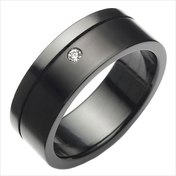 This modern art ring features a clean black steel design
