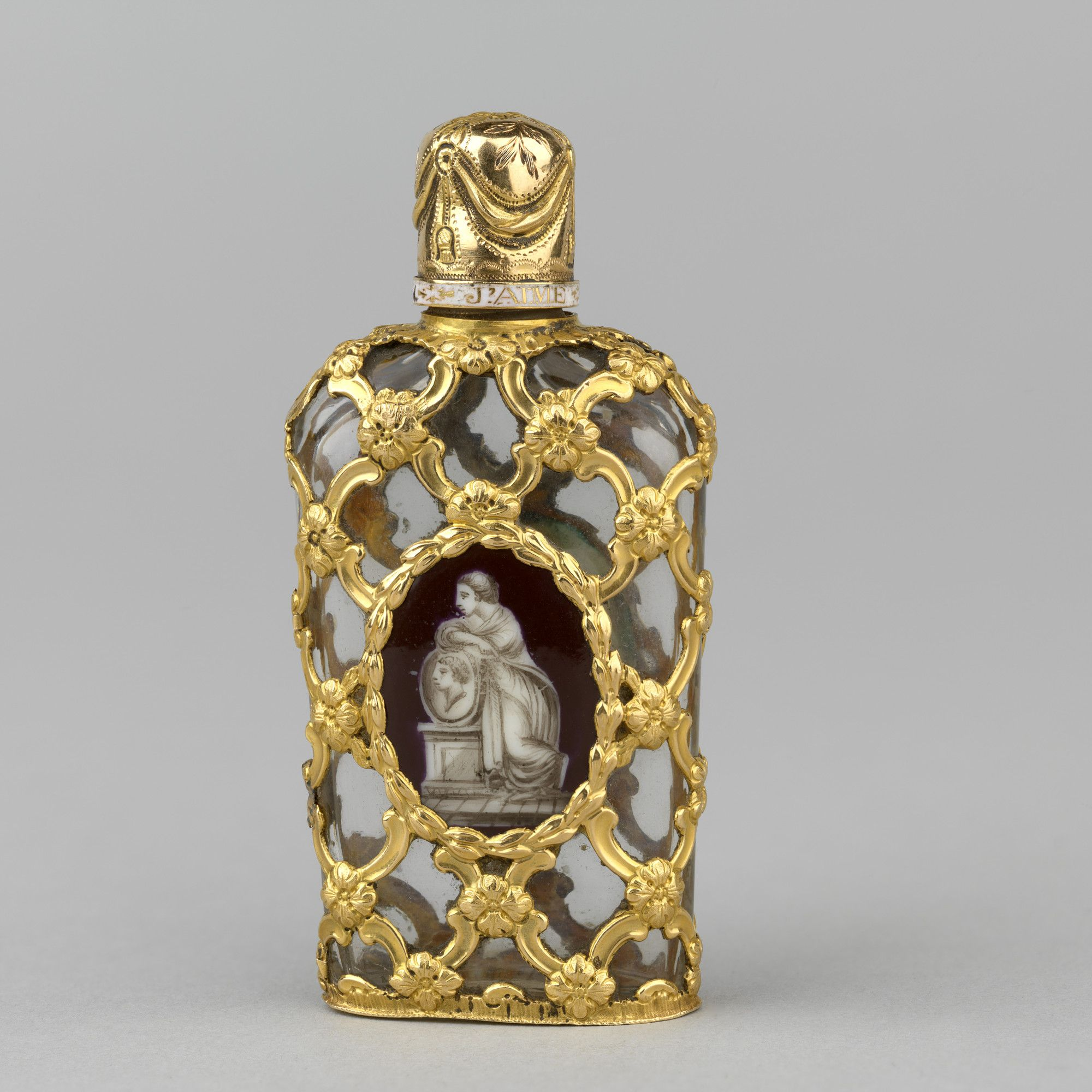 Tall oval in section gold scent bottle