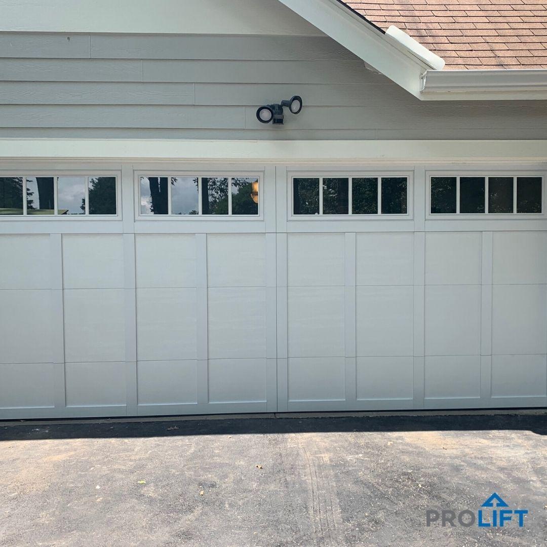 Faux Wood Garage Door Carriage House Style In White Garage Door Styles Garage Doors Single Garage Door
