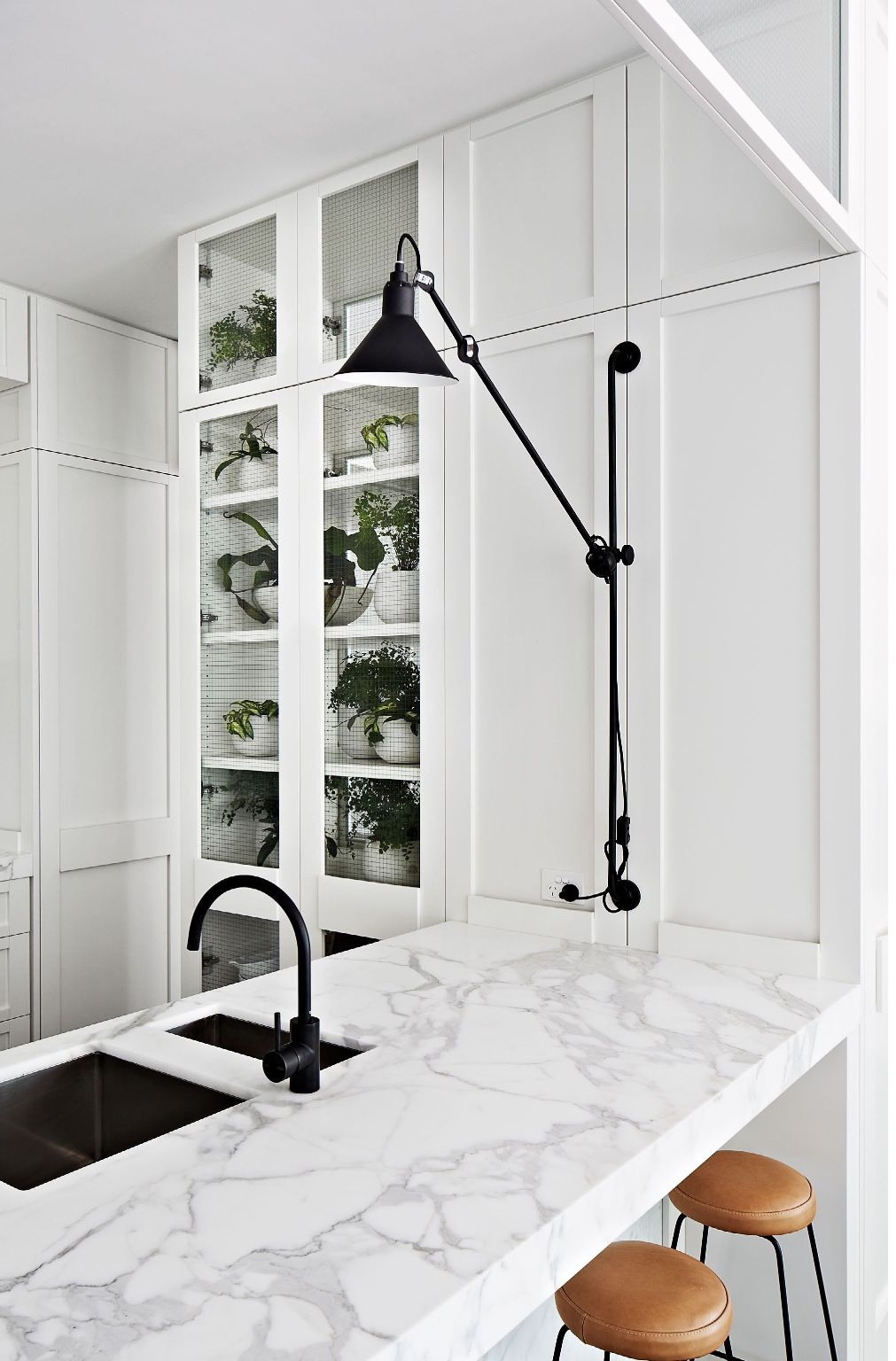 | DETAILS | Classic carrara marble paired with white kitchen with glass cabinet doors to highlight treasured collectables, accent of black.