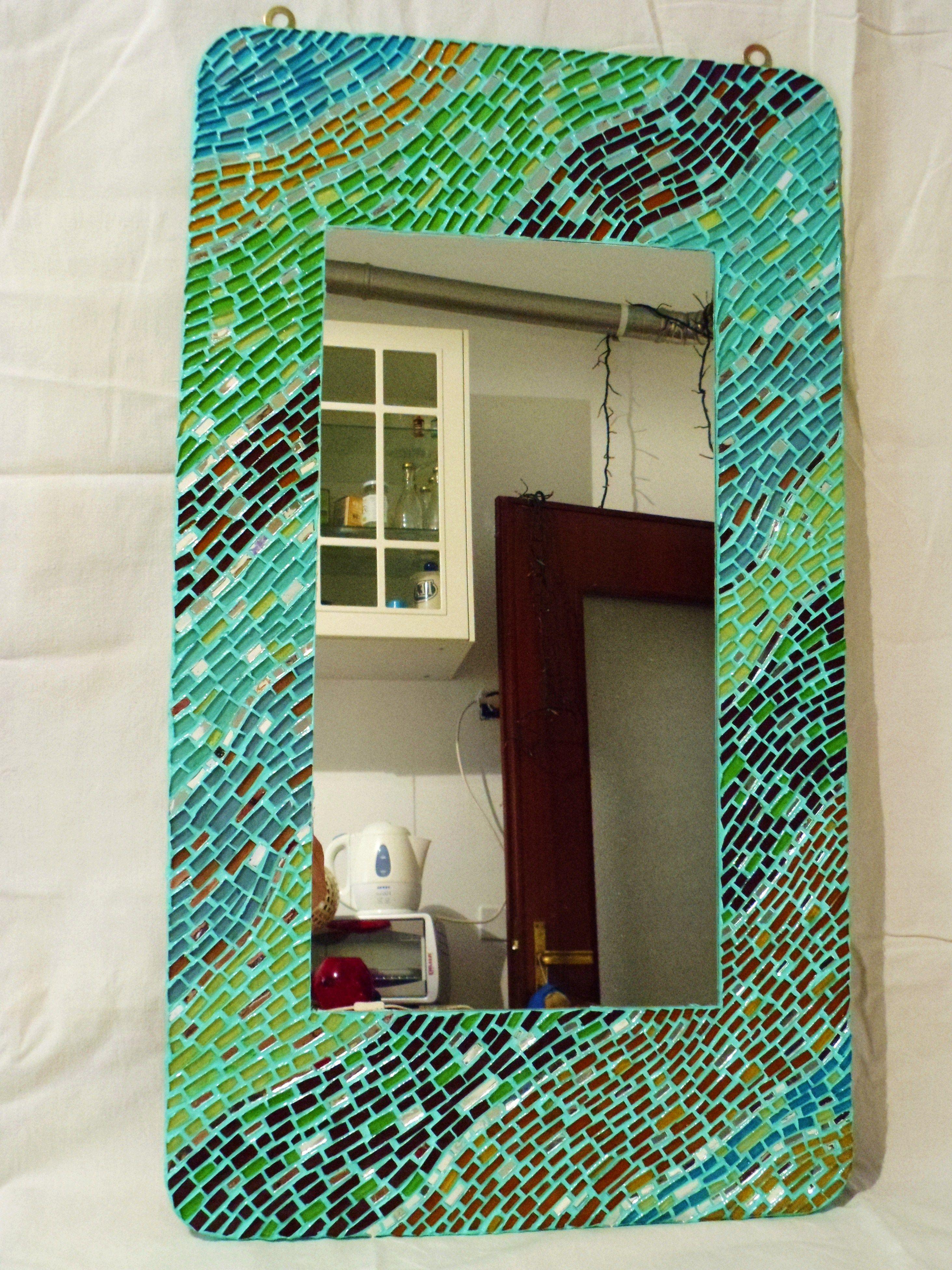 Cornice con specchio mosaicata con vetri cattedrale.Misure