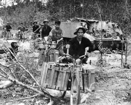 Captured photograph of men moving supplies.