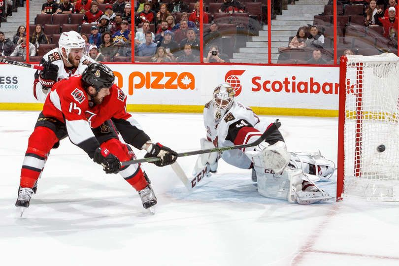 OTTAWA, CANADA - OCTOBER 18: Zack Smith #15 of the Ottawa Senators shoots wide on a short-handed breakaway as Alex Goligoski #33 and Mike Smith #41 of the Arizona Coyotes defends during an NHL game at Canadian Tire Centre on October 18, 2016 in Ottawa, Ontario, Canada. (Photo by Francois Laplante/FreestylePhoto/Getty Images)