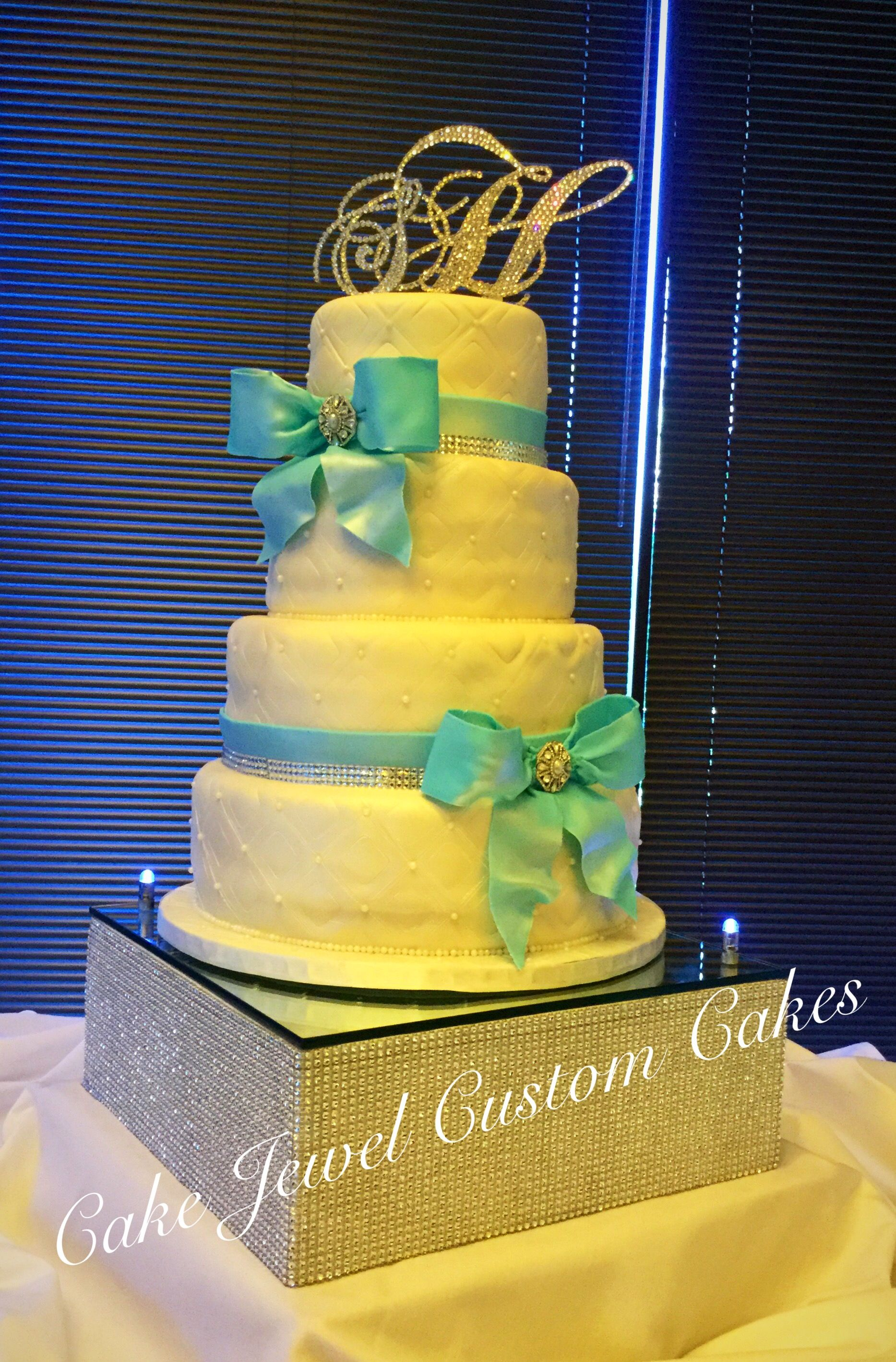 Ivory and Turquoise Wedding Cake with quilt and pearl accent. Red ...
