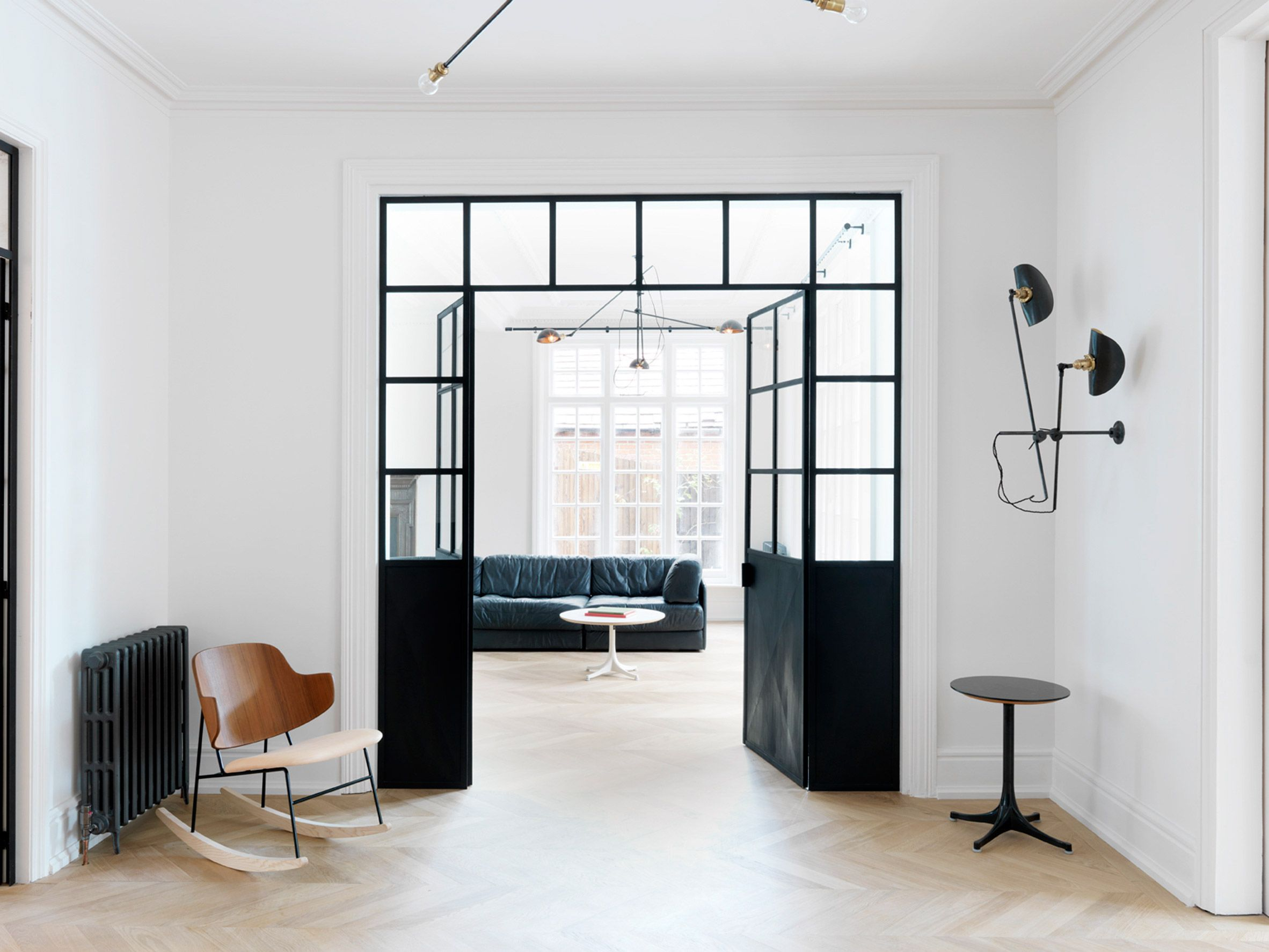 British interiors firm studio maclean used monochrome paintwork oak chevron flooring and cherry wood and marble finishes to overhaul this london house