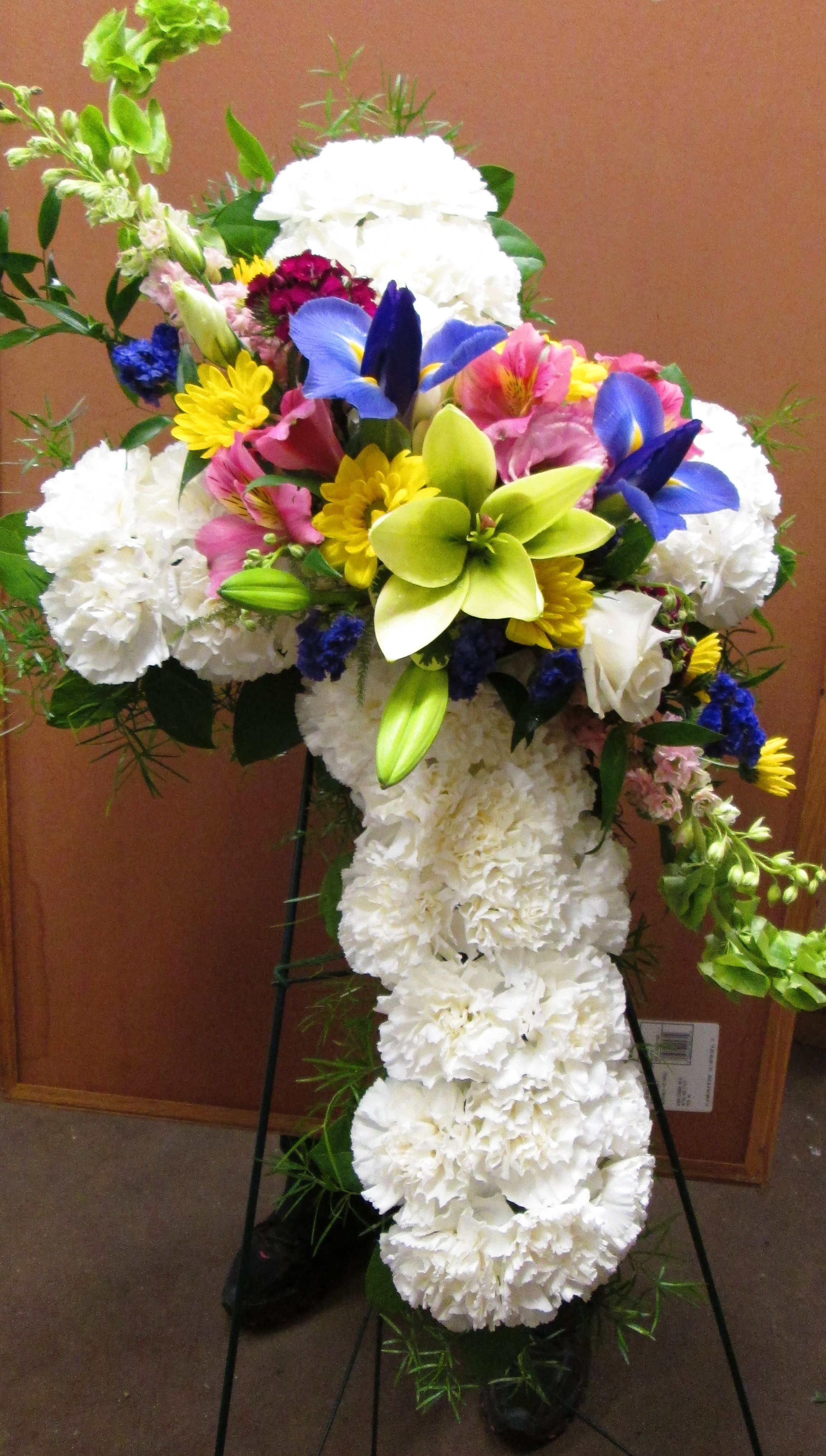 Standing Cross Funeral Spray Made Of White Carnations With A