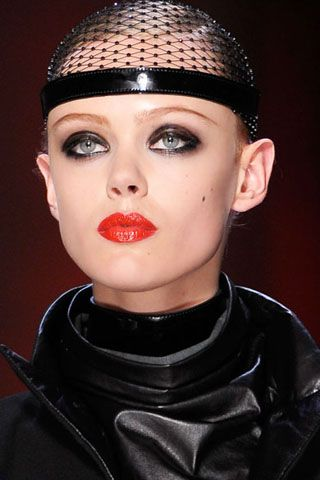 LACQUER FINISH  Slick red lips and glossy black eyelids took center stage on Jean Paul Gaultier's runway.