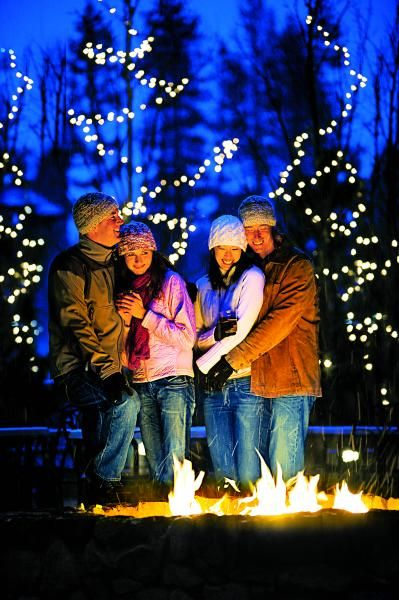 Cuddle up around a fire after a day on the slopes.   Skiing, Resort