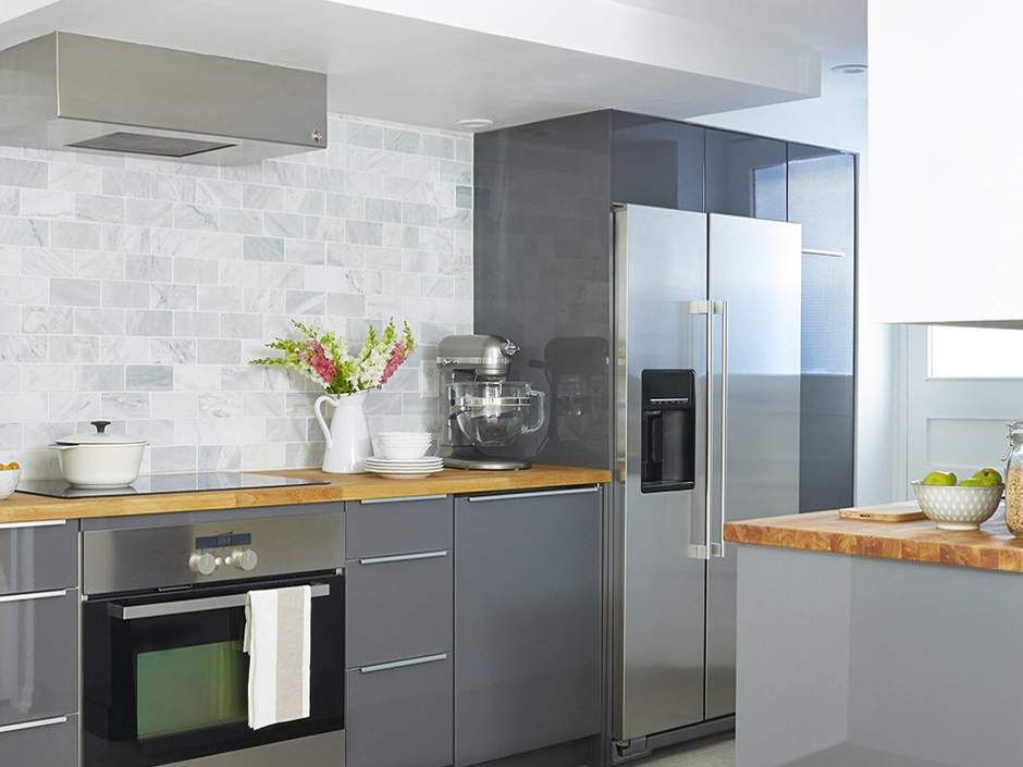 A Small Kitchen With A Low Ceiling Calls For Custom Vent Hood Renovation Interior Design Decorating Basement Kitchen Vent Hood Small Basement Kitchen